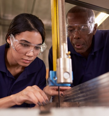 Man and Woman Working with Manufacturing Equipment
