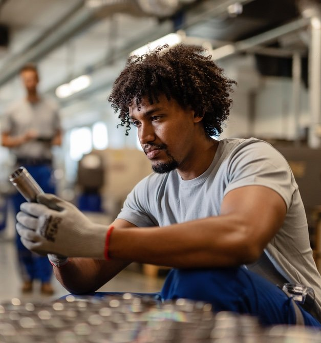 Man Inspecting Product