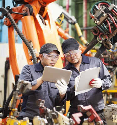 Two Men with Clipboards in Manufacturing Plant